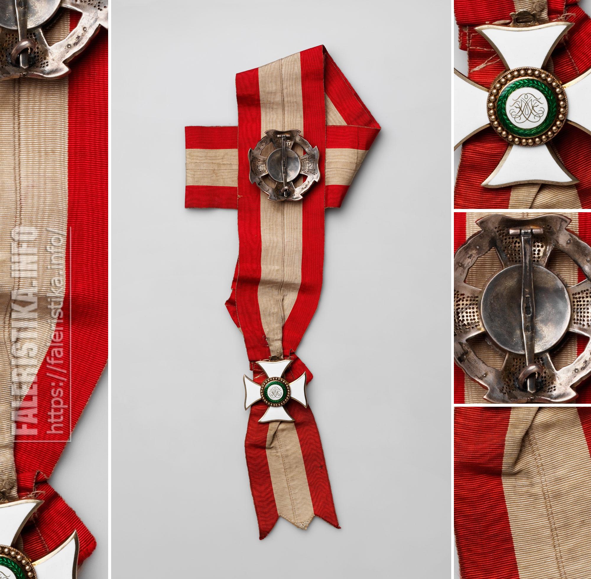 Знак рыцаря Большого креста ордена Марии Терезии на ленте, со звездой. Реверс. Австро-Венгрия. Принадлежала эрцгерцогу Рудольфу (1858—1889). Вена, фирма C.F. Rothe, 1866—1872. Серебро, муар; штамп, золочение, эмаль, гильошировка, ткачество, монтировка. Знак — 5,6х5,4; звезда — дм. 5,7; лента — 130х6,7. Коллекция А.Л. Хазина